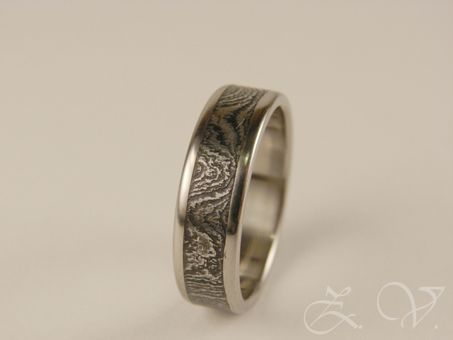 Ring. Damascus steel, titanium.
