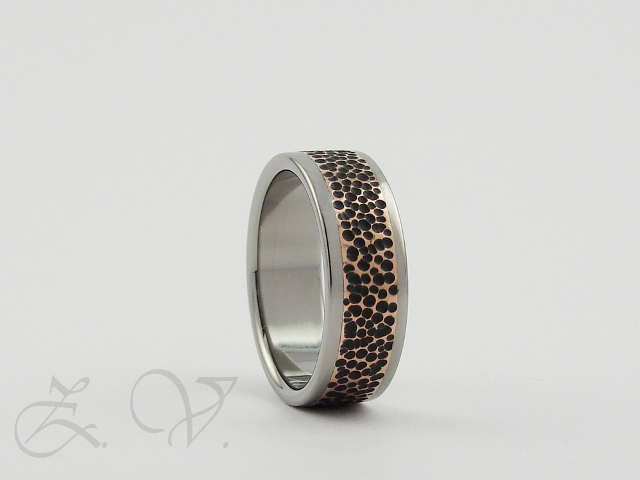 Titanium ring with copper inlay.
