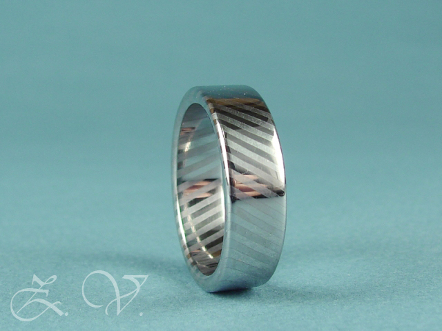Stainless damascus ring.