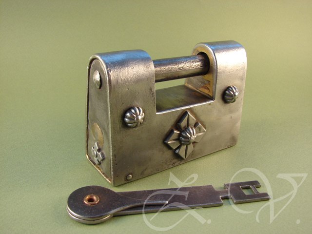 Antique padlock with two trick.Replica.Front view.
